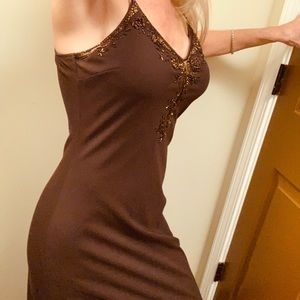 Brown long party dress with sequence accents.